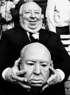 Alfred Hitchcock holding a replica dummy head of himself 1972