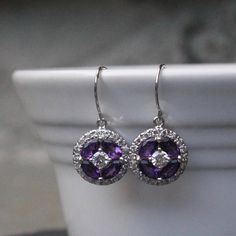 Amethyst marquise and round halo cluster earrings set in