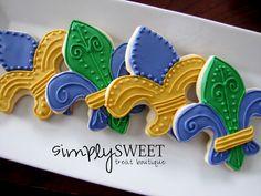 Mardi gras decorated sugar cookies. Royal icing. Yellow, gold, purple, green. Fleur de lis.