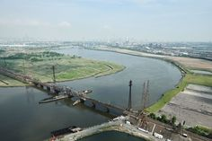 An aerial view of New Jersey's rickety Portal Bridge, with the New York skyline looming in the distance. Grudge Match, Irrigation, Aerial View, New Jersey, Portal, Distance, New York City, New York Skyline, Bridge