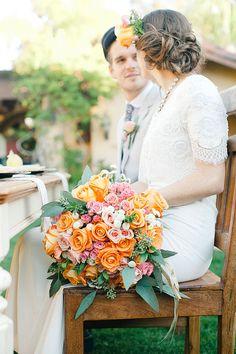 Orange bridal bouquet and lemon grove wedding reception | Amy Carlston Photography | see more on: http://burnettsboards.com/2014/07/summery-citrus-wedding-ideas/