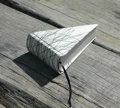 piece of pie book in offwhite with black stitches por Marinabooks