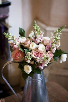 Winter snap dragons, roses and ranunculus milk jug arrangement by iheartflowersuk, via Flickr