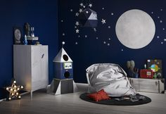 For younger boys, create a space adventure room by using navy blue emulsion like the Tikkurila Joker and highlight with white to create the stars