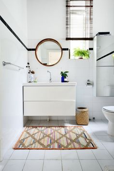 In the master bathroom, a minimal decor approach is used. Image Courtesy: Grounded