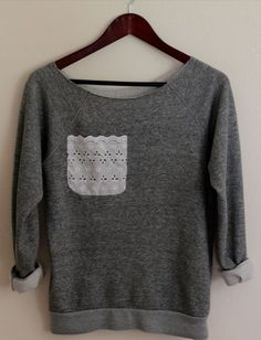 Love the pocket! You could DIY this with an old sweatshirt. :)