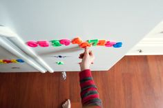 Playing with refrigerator magnets - Family Documentary Photography