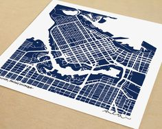 Personalize your home or office décor with this map of Vancouver, Canada. This is a print created using my original hand-drawn map of the citys blocks.