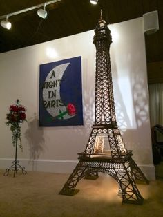 An immaculate seven-foot model of the Eiffel Tower was complemented with a pastiche of a French flower-seller's stall to create a strong focal point on the stage