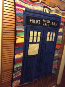 mine with the background being scraps of yarn (Every color but blue, because I didn't want the background to blend with the TARDIS). You can...