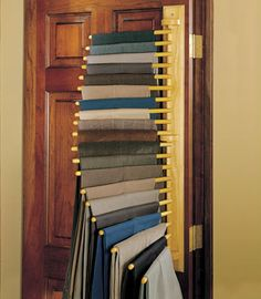 "This cascading pants hanger holds 20 pair of slacks and only projects 16"" into the room. Priced at $64.95 it is a great space saver at a reasonable price! Photo via hammacher.com"