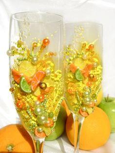 Citrus theme wedding glasses, champagne flutes with lemon, orange and lime slices. $59.00, via Etsy.