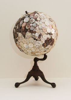 Robin Ayres – My largest button globe. All the buttons are carved mother of pearl and abalone. The buttons are all sewn on. Asia view