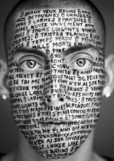 Louise's poetry has enduring appeal...here, a young man has sonnet II inscribed on his face.