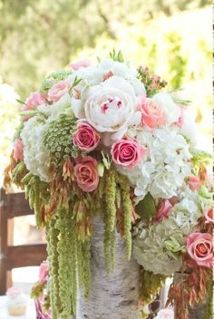 Fairytale wedding: floral arrangement- use tall and short arrangements scattered with books , old keys, vintage candle holders down tables
