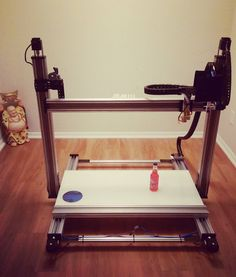 Something we liked from Instagram! Special look at the MILLE 3D printer. This machine is optimized for architecture applications for printing scale models of buildings and landscapes. Bottle of beer for reference.  Made of extruded aluminum. Steel brackets. Carbon fiber electronics plate. RAMBO board. #NEMA23  Working on this project simultaneously alongside the big t console and measures has been exciting. finally I can introduce to you some of the things I've been working on over the last…