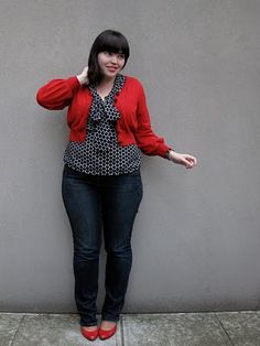 Plus size little red cardi over blue and white polka dot blouse with straight leg jeans and red flats
