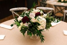 Burgundy dahlias are just breathtaking! This beautiful centerpiece designed by Holliday Flowers and Events. Photo by: Smash Studios Photography