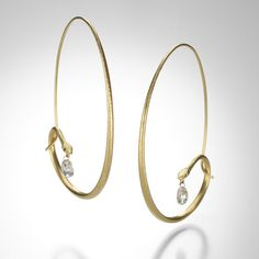 """These snake charmers by Gabriella Kiss are a QUADRUM favorite! Large snake hoops in 18k yellow gold with tiny diamond eyes are the perfect staple for your jewelry wardrobe. The serpents are accented by hypnotizing white diamond briolettes.Diamonds = 1.41cttw.The earrings measure 2"""" long x 1 3/8"""" wide."""