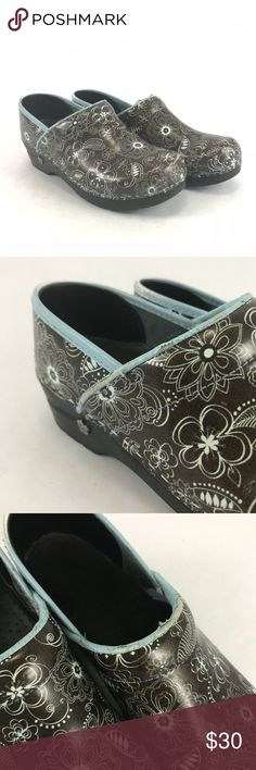 Brown and blue floral woman's Sanita clogs Pre-owned Brown and blue floral woman's Sanita clogs. Woman's size 39. See pictures for condition. These do have some cracking to the leather on the upper rim and scratching to the toes. Sanita Shoes Mules & Clogs