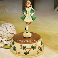 """Musical Irish Dancer This Irish lass will dance her way into your heart! Dressed in traditional Irish costume the 7"""" figurine is adorned with shamrocks and plays """"Irish Lullaby"""". Please state name up to 24 characters."""