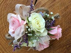 Loved it! Pinned it! A Blooming Envy Design! Corsage designed with white and blush roses, baby's breath and limonium.