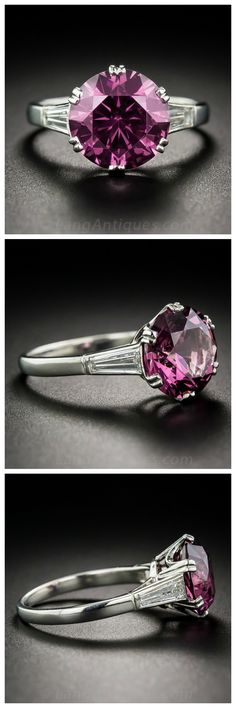 5.69 Carat Rhodolite Garnet & Diamond Ring A deep raspberry-violet-pink (hard to describe the exotic color) Rhodolite garnet, weighing 5.69 carats, casts an entrancing glow between a sizable (a third-of-a-carat each) pair of tapered baguette diamonds, in this singular, sensational, fun and festive, colorful, yet classic, solitaire ring. Beautifully hand fabricated in platinum, the gemstone is secured by six expertly sculpted split prongs. #langantiques #rhodolite #vintagering
