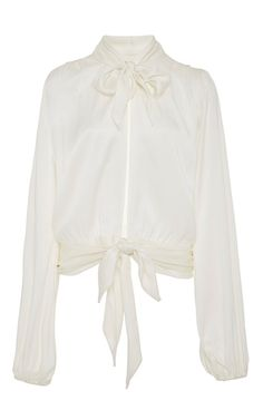 This **Awave Awake** Three Tie Blouse is rendered in silk charmeuse and features a neck tie with an open front and a tied waist.