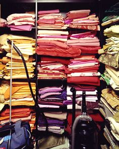 Stacks of brightly colored fabric.