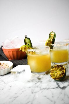 These Charred Lime & Jalapeño Margaritas put all others to shame. Smoky, citrusy, and oh-so refreshing, this margarita is fit for Cinco de Mayo. Classic Cocktails, Summer Cocktails, Cocktail Drinks, Fun Drinks, Yummy Drinks, Cocktail Recipes, Beverages, Vodka Cocktails, Drink Recipes