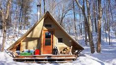 In this video, we give you a tour of a prospector-style, 4-season tent that is completely off-grid. The tent is built with two layers of weather-proof canvas stretched over a wooden frame and is equipped with a double combustion wood stove for heat, a solar panel to power 1 LED light, and a propane fridge to keep food cool during the summer months. The tent is separated into 4 quarters: dining room, kitchen, sleeping area, and woodstove/living room. There's also an outhouse, barbecue...