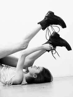 There's something about this picture that I find pretty. Maybe it's the black&white or her position.....?
