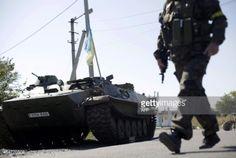 02-23 An Ukrainian serviceman walks past an armoured personnel... #karlovka: 02-23 An Ukrainian serviceman walks past an… #karlovka
