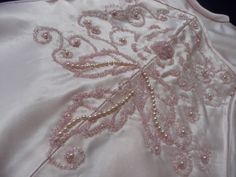 Close up of beadwork on pink coloured Angel gown.