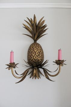 I've been a little bit in love with pineapple sconces since I saw this gorgeous shot of a bedroom on Little Green Notebook earlier this year. For months and months, I scoured eBay looking for something vintage with no luck. OK, it was more than a little bit in love.I was…