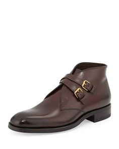 """Tom Ford calfskin leather boot with gold hardware. 1.3"""" stacked heel. 4.2""""H shaft; 10.5"""" circ. Tapered round toe. Double-buckle straps across ankle. Leather lining and insole. Rubber sole. """"Edward"""" is"""