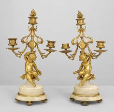 Pair Of French Victorian Bronze Dore 3 Arm Candelabra With Cupid On Oval Shaped Onyx Base With Finial