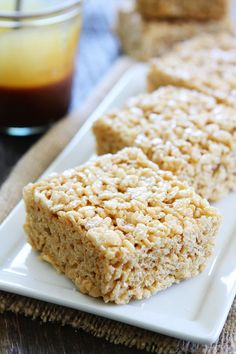Salted Caramel Rice Krispies Treats Recipe on twopeasandtheirpod.com Classic Rice Krispies Treats made even better by adding salted caramel sauce and a sprinkling of sea salt!