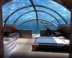 Unique Getaways - Ever wonder how it feels to sleep underneath the ocean?  Guests at the Poseiden Resort in the Bahamas, take an elevator 40ft under the sea, and stay in one of the 24 suites or the in the sole luxury apartment. With 70 percent of the room(s) encased in see-through acrylic casing, guests can 'really' experience what living the in ocean feels like.