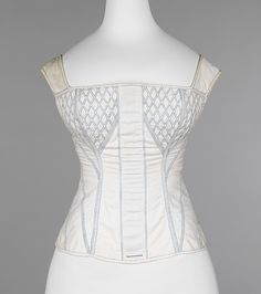 Corset Date: 1830–35 Culture: American Medium: cotton, bone Dimensions: 21 in. (53.3 cm) Credit Line: Brooklyn Museum Costume Collection at The Metropolitan Museum of Art, Gift of the Brooklyn Museum, 2009; Gift of Mrs. Richard Herz, 1967 Accession Number: 2009.300.2892a, b