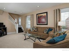 Spacious, neutral living room with lots of natural light  177 Walton Dr, Amherst, NY | $239,900