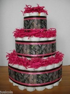 Diaper cake . Maybe do half pink half green for not knowing gender