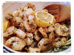 """OVEN BAKED SHRIMP """"SCAMPI"""" RECIPE: toss 1 1/2 lbs uncooked shrimp (deveined) w/ 2Tb coconut oil, 3-4 cloves crushed garlic, 3Tb ranch seasoning, zest & juice from 2 limes; layer evenly onto shallow baking sheet (prepared w/ non-stick spray); top w/ lemon slices; bake @350F until done (about 15 mins). For a more traditional scampi flavor: use 1/2 stick butter & Italian or Herbs de Provence seasoning instead of the coconut oil/ranch (omit the lime) & top w/ bread crumbs/grated Parmesan. Enjoy…"""