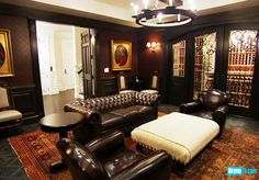 dream library with paneled walls, leather club chairs, chesterfield sofa....