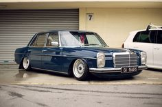Mercedes W114  on BBS wheels, lowered with Euro spec headlights.