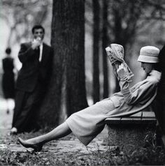 I love this lovely black and white photo of a woman taking a break in the park... Who is her admirer, and what does he want?!: