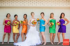 bride and bridesmaids in front of garage door