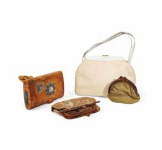 A group of four handbags designed by Schiaparelli in the sale include an embroidered velvet clutch and a handsome white bag. A GROUP OF FOUR SCHIAPARELLI HANDBAGS, CIRCA 1940-