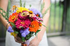 Bright zinnia bouquet.  End of summer, Michigan,  farm wedding.  @studiosnap