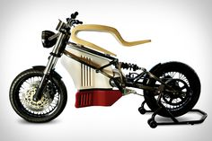 It's not the most functional bike out there. But the Expemotion E-Raw Motorcycle is one of the best-looking. The design is dominated by the seat - made from laminated layers of wood, it provides the look and feel of furniture...